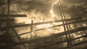 Wooden fence and lightning