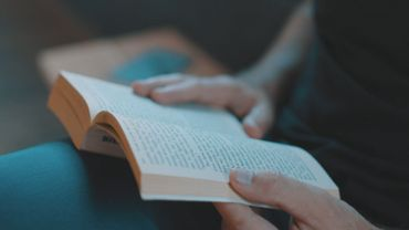 A person reading a book, close up