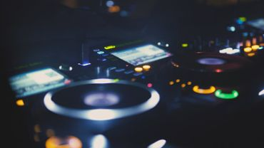 Close up of a DJ playing music at nightclub