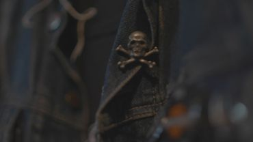 Skull pin on denim jacket