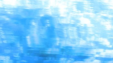 Water surface and blue sky