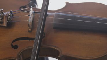 Man playing violin close up