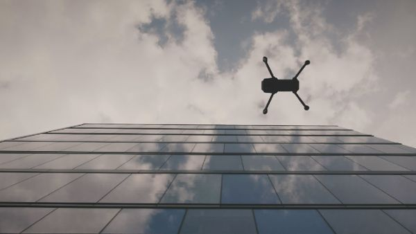 Drone flying over office building