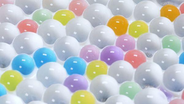 Colorful spheres floating in liquid
