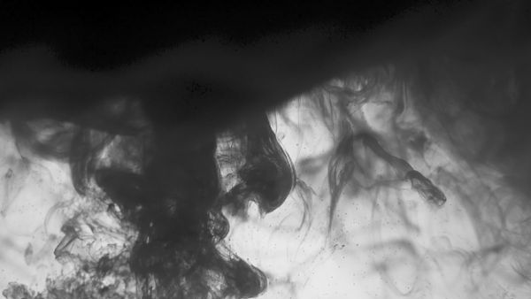 Black ink swirl in water